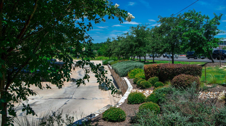 Trimmed shrubs on apartment landscape