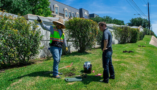 Commercial landscaping crew maintaining irrigation in Austin, TX