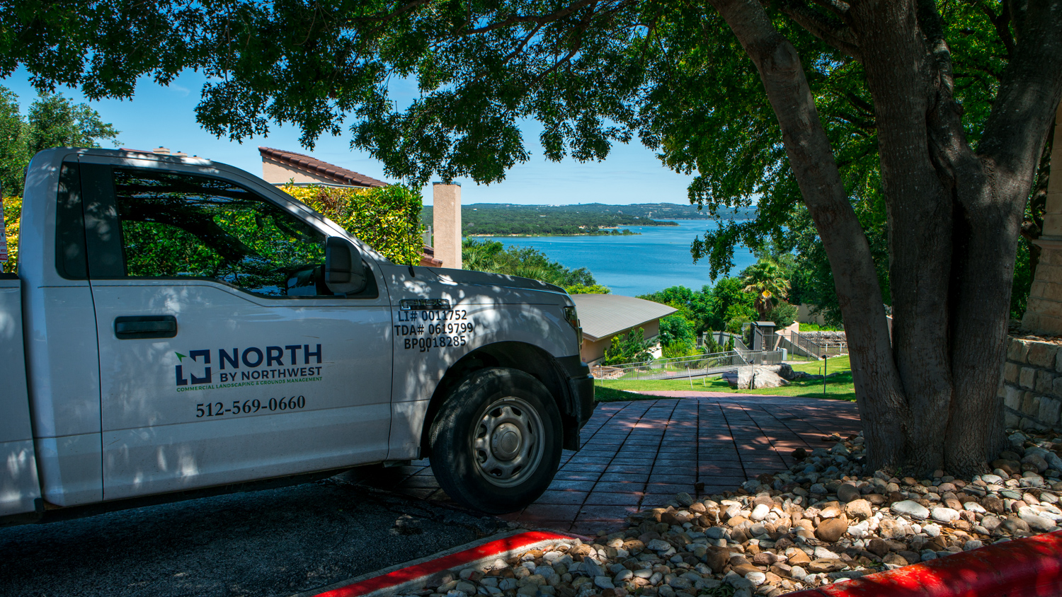North By Northwest Landscaping truck near stone