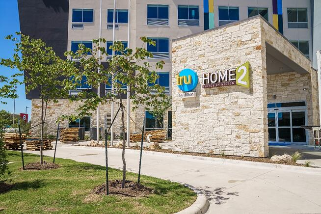 Tru and Home2 Suites By Hilton entrance and landscape
