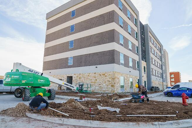 commercial landscapers working at Tru and Home2 Suites By Hilton